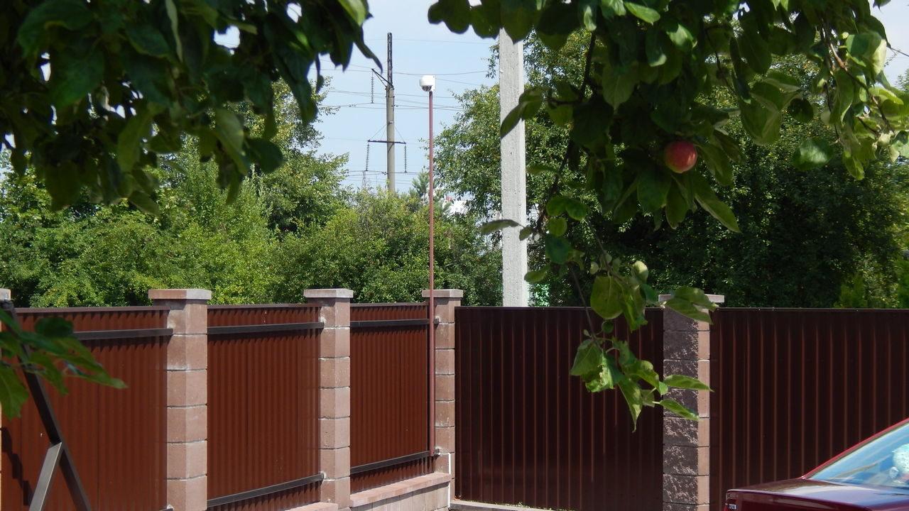 IP камера на заборе